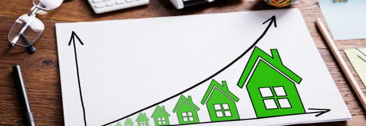 Investieren in Sachwerte: Wie Immobilien reine Geldwerte übertreffen